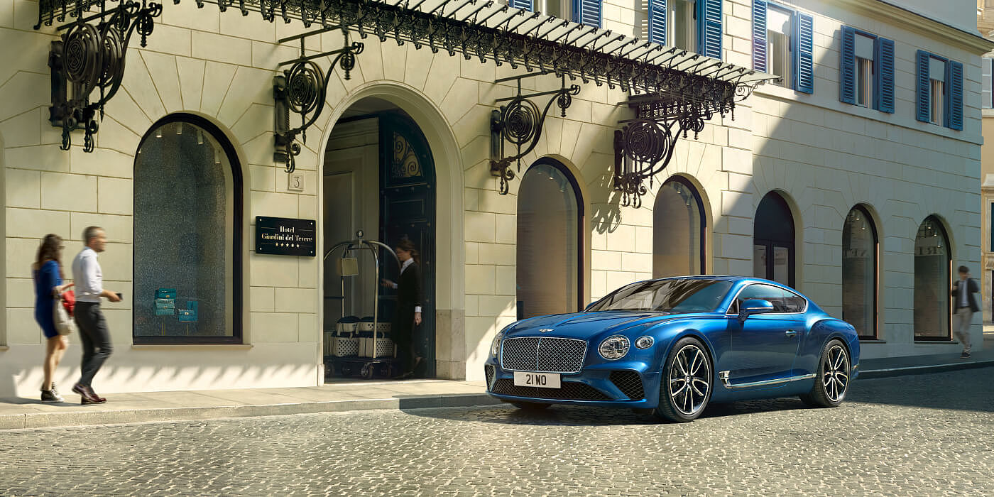 BENTLEY-CONTINENTAL-GT-IN-SEQUIN-BLUE-PAINT-PARKED-ON-CITY-STREET-ITALY